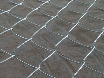 Galvanized chain link fence with square holes is on the floor.