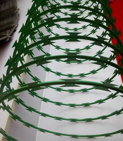 A stretching coil of concertina razor wire is on the exhibition stand.