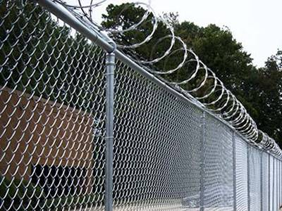 Chain link fence - concertina wire is used as security fence