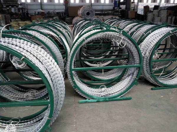 Several sets of razor wire mobile security barriers in the warehouse.