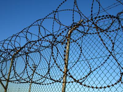 razor wire fence installed on chain link fence for security